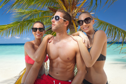 cool guy with girls under palmtree